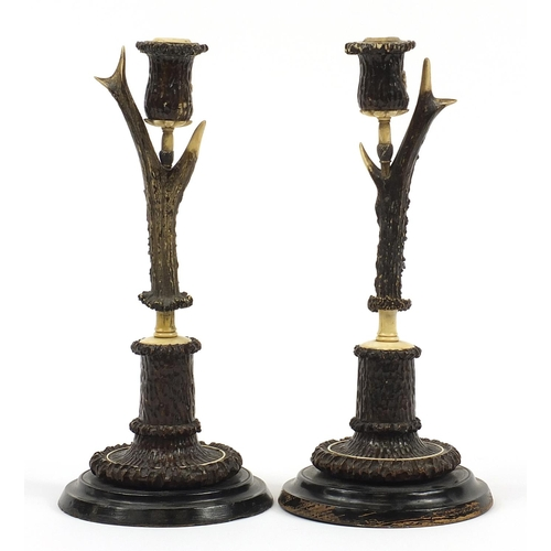 10 - H F C Rampendahl, Pair of 19th century antler horn and bone candlesticks carved with stags and hunti...