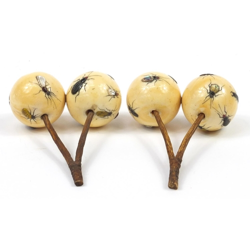 29 - Pair of Japanese carved ivory Shibayama cherries inlaid with insects, each 9cm in length...