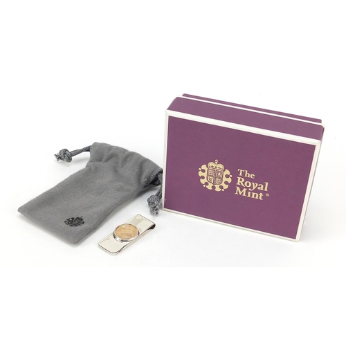 39 - Elizabeth II 2020 gold half sovereign silver money clip with box, by the Royal Mint, 5.2cm in length...