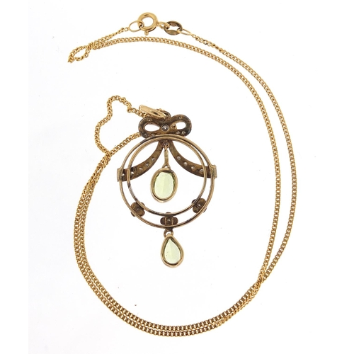 35 - Art Nouveau 9ct gold peridot and diamond pendant on a 9ct gold necklace, housed in a Victorian velve...