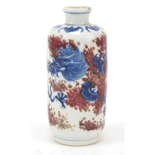 Chinese blue and white with iron red porcelain vase hand painted with a dragon amongst flames chasing a flaming pearl, 13cm high