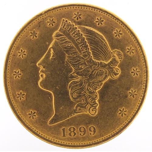 320 - United States of America 1899 gold twenty dollars, Liberty head to the reverse, 33.6g - this lot is ...