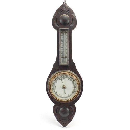 Carved oak aneroid barometer with thermometer, 58.5cm high
