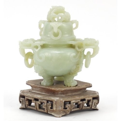 37 - Chinese carved green jade tripod censer with ring turned dragon handles on carved hardwood stand, ov...