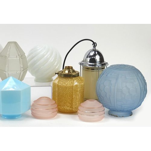 7 - Art Deco and later glass shades including a large frosted blue glass example having a geometric desi...