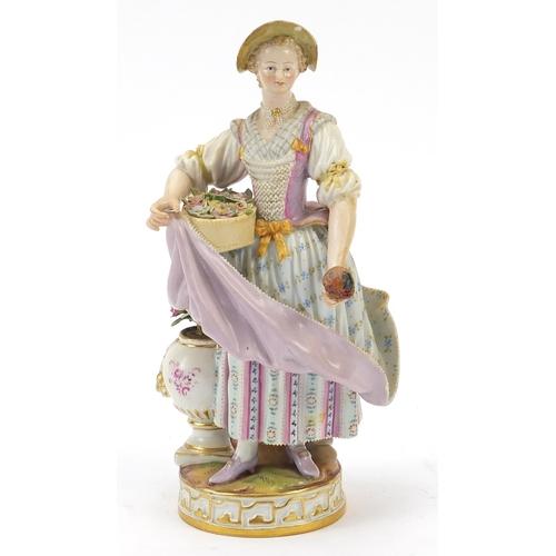 2 - Meissen, 19th century German porcelain figurine of a female holding flowers, blue crossed sword mark...