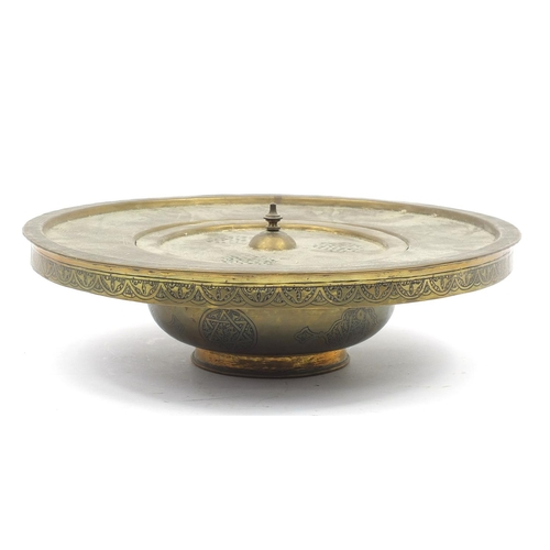 58 - Islamic Cairoware brass incense stand with pierced lid engraved with calligraphy, 9cm high x 32cm in...