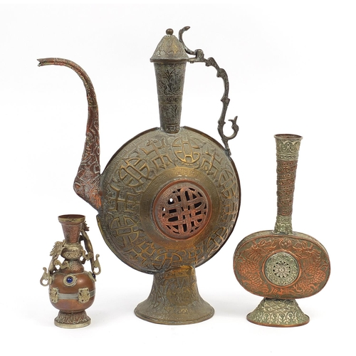 56 - Tibetan metalware including a large wine ewer and vase decorated in relief with two dragons and appl...