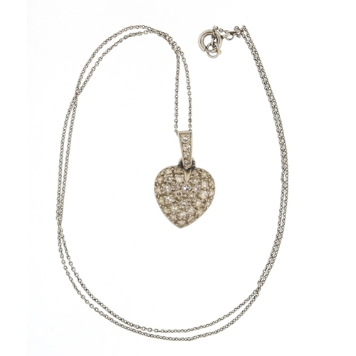 14 - Unmarked white gold diamond love heart pendant on a unmarked white metal necklace, 2cm high and 40cm...