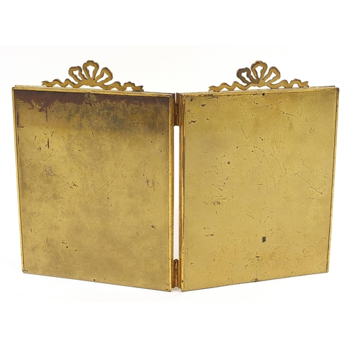 19 - Edwardian brass double photo frame with bow decoration, overall 32cm x 47cm...