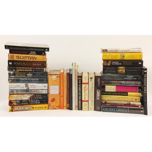 Hardback books including novels by Harry Sidebottom, Ben Kane, Cleopatra the Great, The Mughal World, The Stories of the Greeks, The Illustrated Guide to Classical Mythology and the Complete Works of William Shakespeare with slip case by The Royal Shakespeare Company