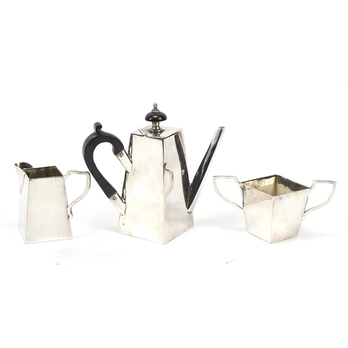 273 - Silver plated three piece teaset in the manner of Christopher Dresser, the largest 12.5cm high