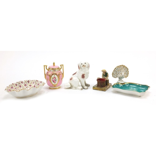 Early 19th century and later ceramics including a Minton's vase and cover with twin handles hand painted with roses, peacock dish and Spaniel, the largest 14cm wide