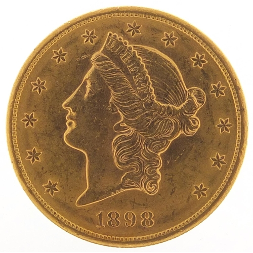 525 - United States of America 1898 gold twenty dollars, Liberty head to the reverse, 33.6g - this lot is ...