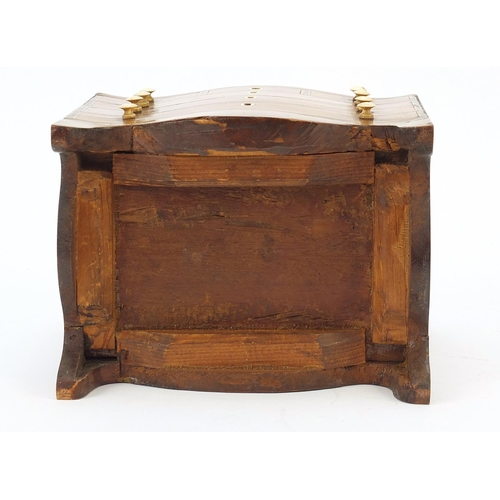 23 - Victorian inlaid mahogany tea caddy in the form of a serpentine fronted six drawer chest, 17cm H x 1...