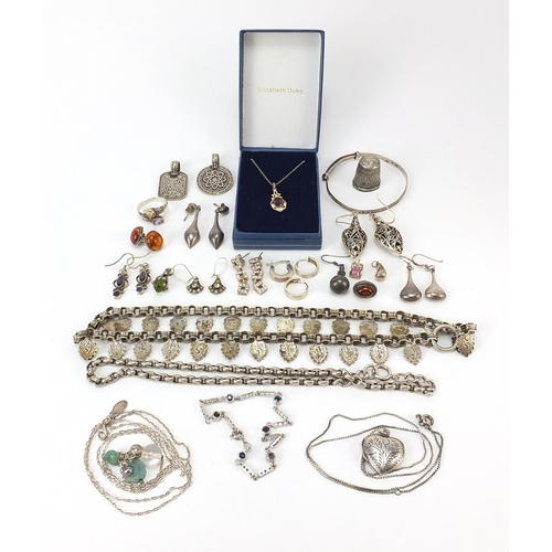Silver and white metal jewellery including necklaces, christening bangle, amber earrings and bracelets, 128.0g