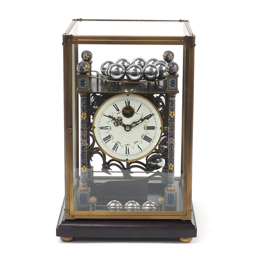 6 - Champlevé enamel rolling ball clock with enamel dial having Roman numerals and glass display case, o...