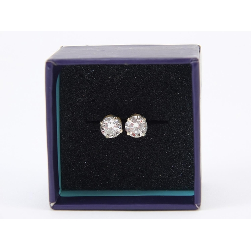 19 - Pair of 14ct gold diamond solitaire earrings, each approximately 5.5mm in diameter x 3.5mm deep...