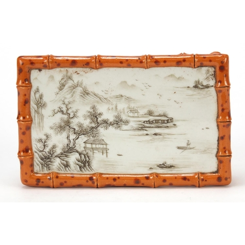 57 - Chinese faux bois grisaille porcelain stand hand painted with a river landscape, four figure gilt ch...