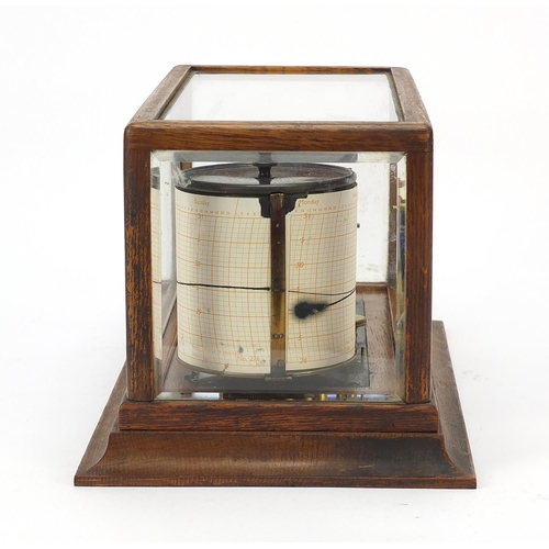 8 - Victorian eight ring barograph with charts housed in a glazed oak case, 18cm H x 35cm W x 20cm D...
