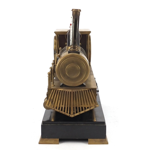 46 - Large steam train design clock and barometer with thermometer having enamel dials, raised on a recta...