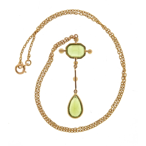 18 - Art Nouveau 15ct gold peridot and pearl pendant necklace, 40cm in length, the pendant 4.2cm high, 5....
