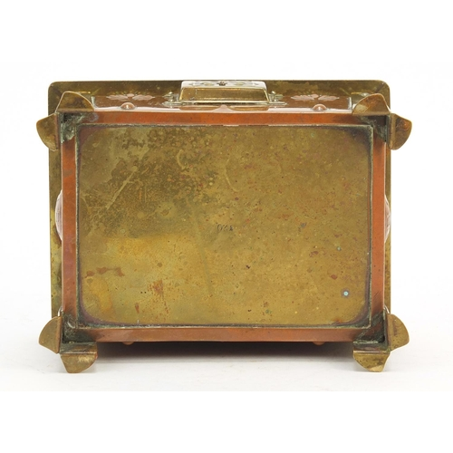 3 - Arts & Crafts enamel, copper and brass casket with embossed floral motifs raised on four stylised fe...