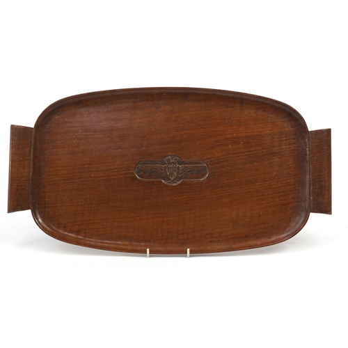 1450 - Military interest hardwood tray with twin handles and carved crest, 60cm in length...