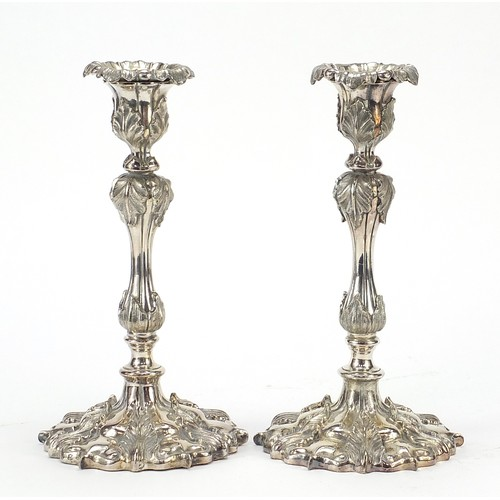 16 - Pair of 19th century classical silver plated acanthus leaf candlesticks, each 25.5cm high...