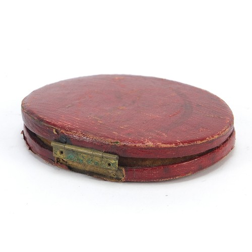 31 - Georgian oval hand painted portrait miniature of a gentleman housed in a red leather case with silk ...