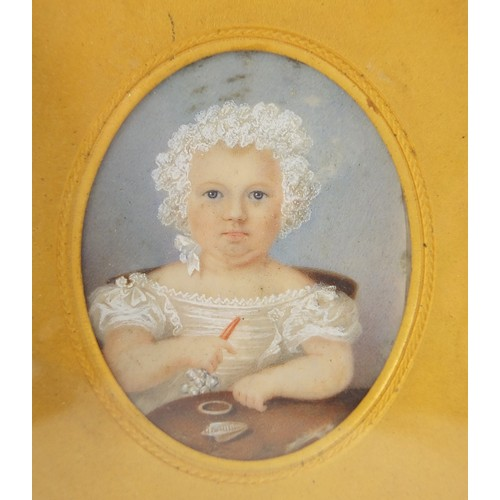 32 - 19th century oval hand painted portrait miniature of a young girl holding a rattle, housed in a leat...