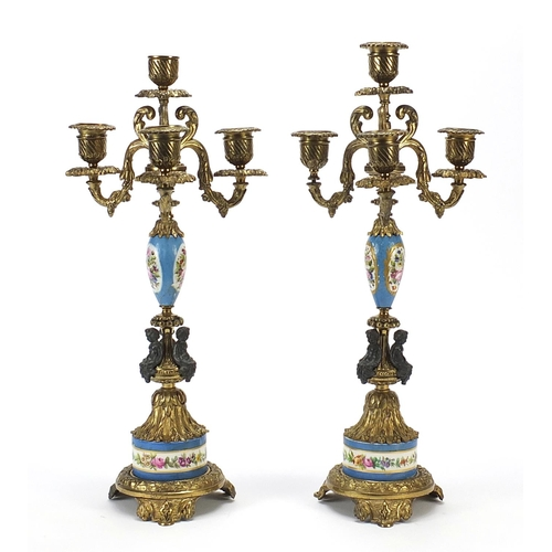 2 - Pair of classical gilt metal and Sevres style four branch candelabras hand painted with flowers, eac...
