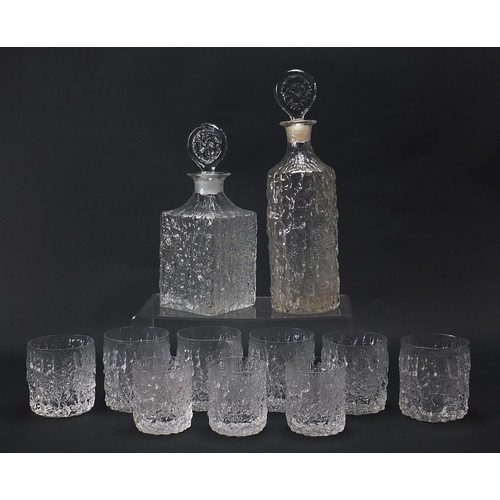54 - Geoffrey Baxter for Whitefriars, textured glassware comprising two decanters, set of six tumbles and...