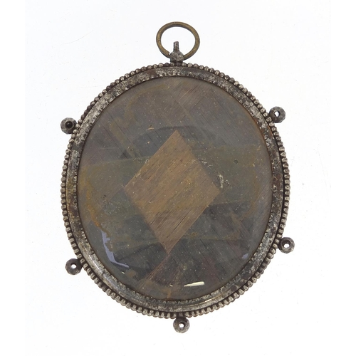 25 - Georgian oval hand painted portrait miniature of a gentleman housed in a steel mourning pendant, the...