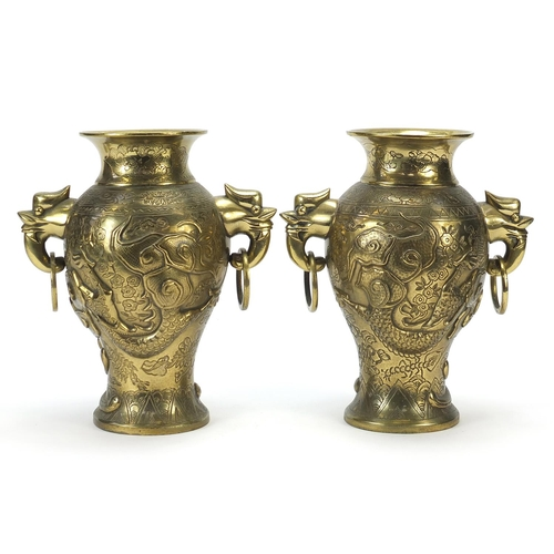 12 - Pair of Chinese bronze vases with ring turned bird's head handles, each cast with dragons, fish and ...