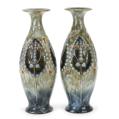 38 - Royal Doulton, pair of Art Nouveau stoneware vases decorated with stylised flowers, each 32cm high