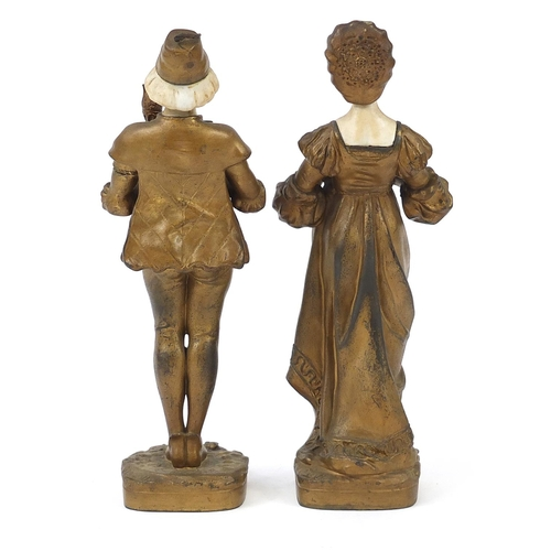 42 - Pair of gilt metal and alabaster figures of a boy and girl in dutch dress, the largest 28.5cm high