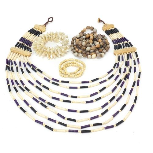 Ethnic jewellery including bone, ebony, mother of pearl and pips