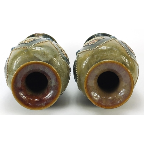 37 - Ethel Beard for Royal Doulton, pair of Art Nouveau stoneware baluster vases decorated with stylised ...