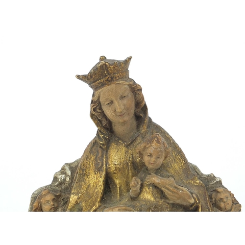 26 - 19th century Continental gilt and silvered carved wood icon of Madonna and child, 16.5cm high