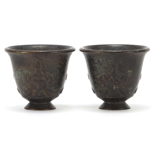 Pair of Chinese patinated bronze tea bowls, each approximately 4.5cm high