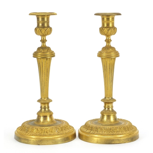 29 - Pair of Antique French Louis XVI style ormolu candlesticks, each 28cm high
