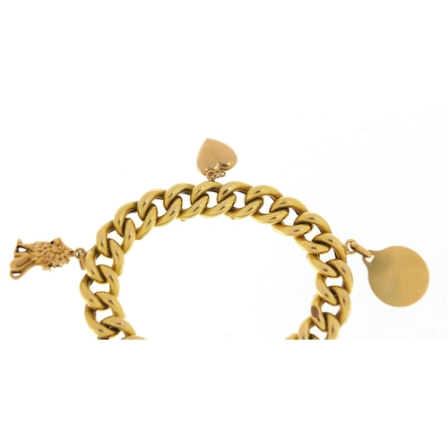 32 - Continental 18ct gold bracelet, probably French with a selection of gold charms including a seated l...