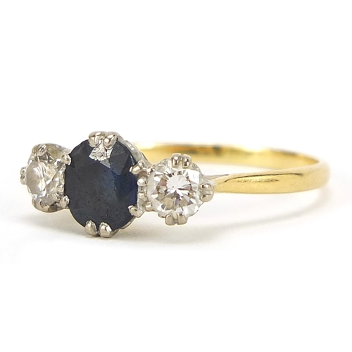 13 - Unmarked gold, sapphire and diamond three stone ring, the sapphire approximately 7mm x 6mm, the diam...
