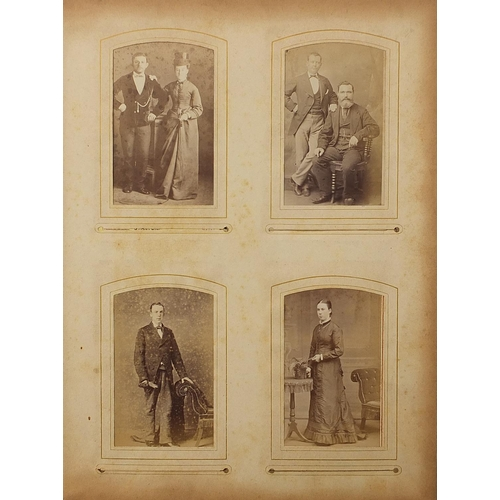 Two Victorian cabinet card albums containing cabinet cards
