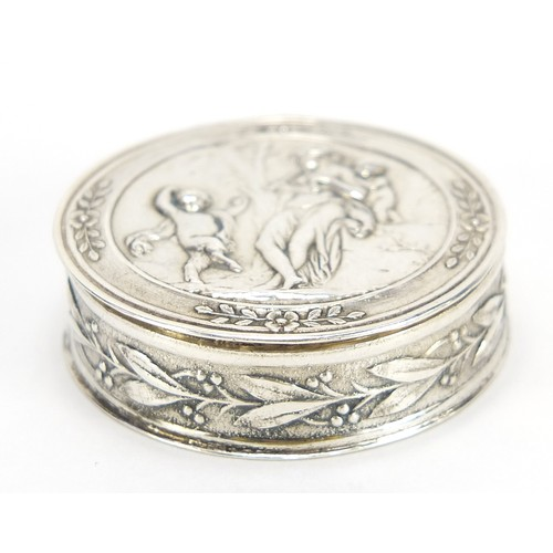 French silver pill box with hinged lid, gilt interior and embossed with classical figures, 3cm in diameter, 12.5g