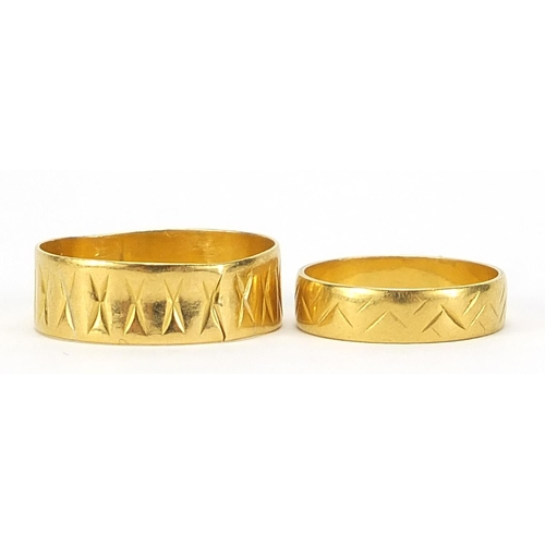 665 - Two Elizabeth II 22ct gold wedding bands with engraved decoration, London 1976 size P and Birmingham...