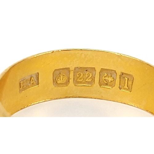 702 - Three George V 22ct gold wedding bands, Birmingham 1910 size N, Birmingham 1930 size O and one with ...