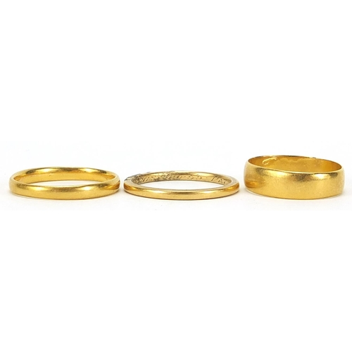 695 - Three 22ct gold wedding bands, Birmingham 1915 size O, London 1933 size T and one with indistinct ha...