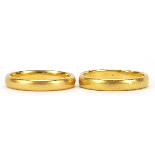 705 - Two 22ct gold wedding bands, London 1906 size M and Birmingham 1960 size N, total 7.3g - this lot is...